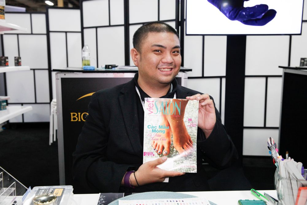<p>Bio Seaweed Gel's Kenneth Vo with the latest copy of VietSALON Magazine!</p>