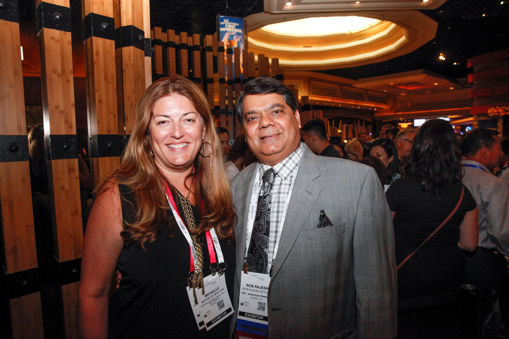 <p>NAILS publisher Michelle Mullen and American Dawn's Ron Kothari</p>