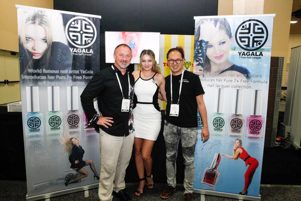 <p>Yagala's Sergei Bargamotov and Galina Sadovenko debuted the Yagala polish line at Cosmoprof with Nail Labo's Shinya Fujinami</p>