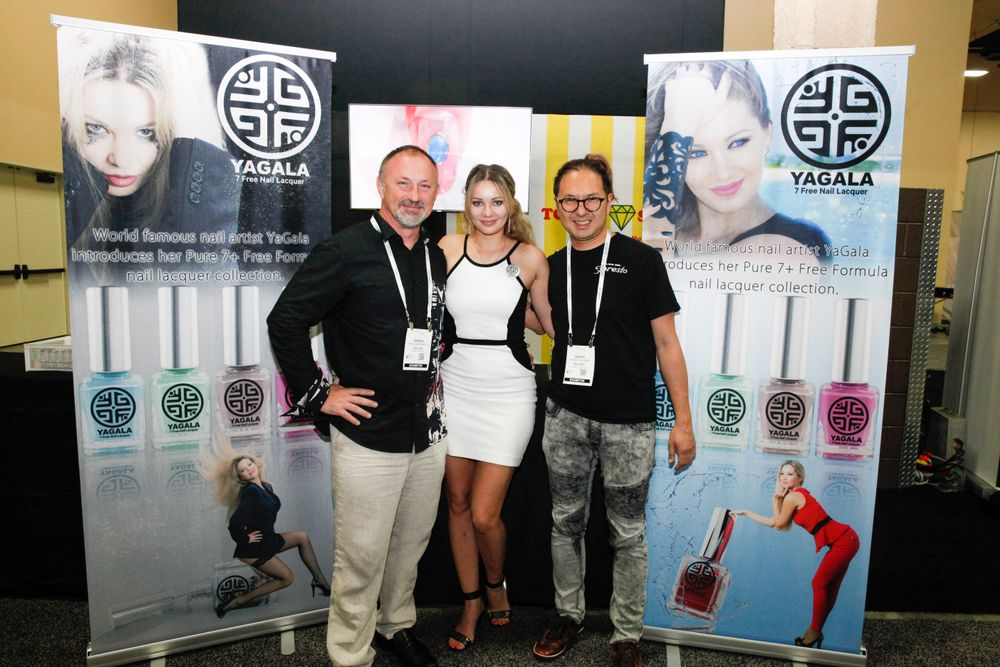<p>Yagala's Sergei Bargamotov and Galina Sadovenko debuted the Yagala polish line at Cosmoprof with Nail Labo's Shinya Fujinami</p>