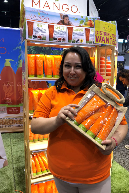 <p>Rosy Ocampo shows off California Mango's new packaging.</p>