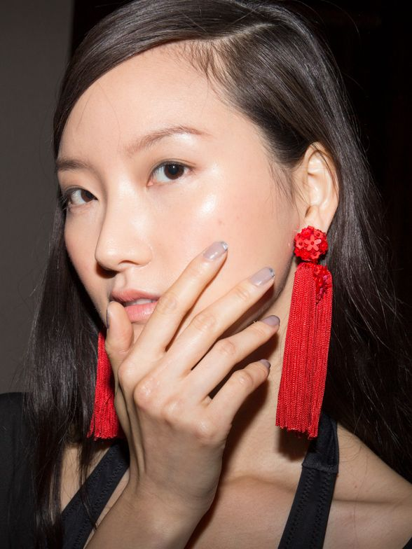 <p>Geraldine Holford created a metallic french manicure using Dermalect Cosmeceuticals' line of peptide-infused nail lacquers for Sachin + Babi. Photo courtesy of Carissa Lancaster.</p>