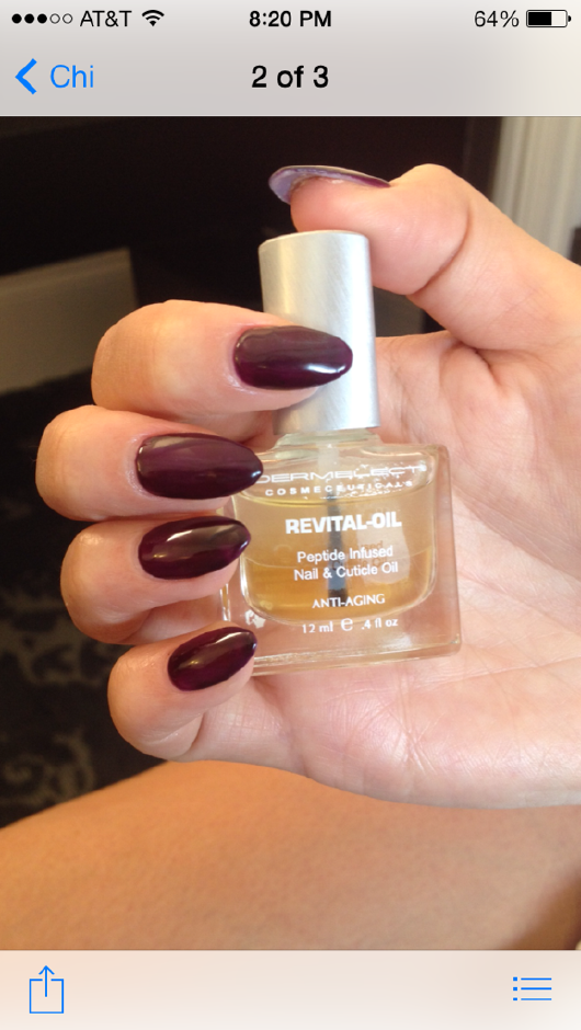 <p>Chrissy Teigen's dark burgundy nails were topped off with Dermelect's Revital-Oil. Image courtesy of Dermelect.</p>