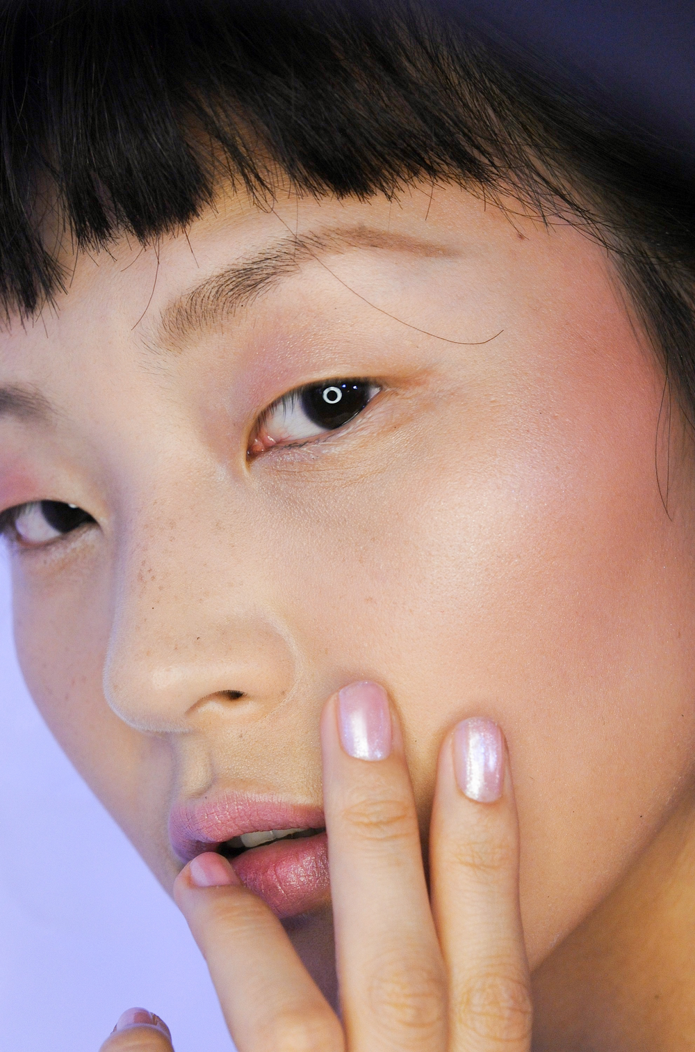 <p>Shimmering nails in new <strong>CND </strong>Grapefruit Sparkle shimmered like ballerina slippers on the runway. These nails played up the chiffons, watercolor florals, and pastel lilac prints at Christian Siriano.</p> <p><em>Photo courtesy of CND</em></p>