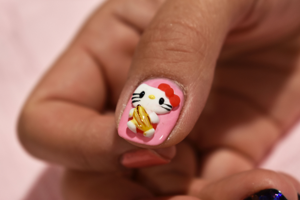 """<p>Julie Le of <a href=""""https://www.instagram.com/nailartslanger/"""">@nailartslanger</a>created this 3-D Hello Kitty at Christrio</p>"""