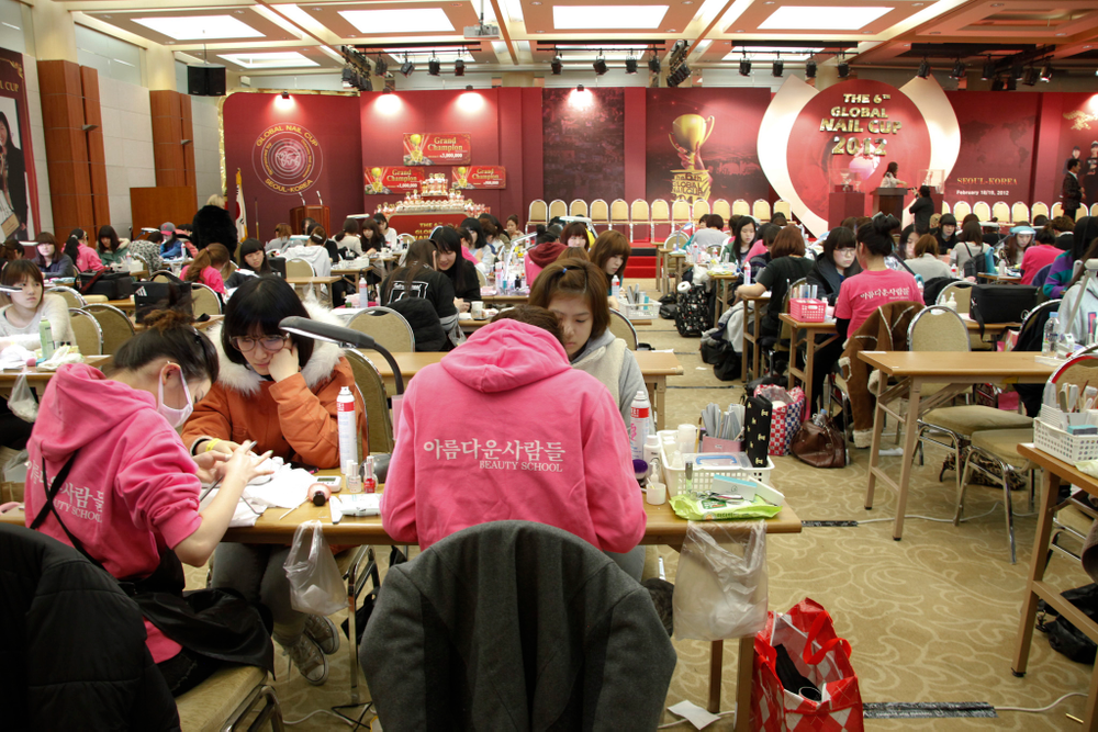 <p>Many competitors represented their respective nail academies. These competitors represent the Areumdaun Saramdul (The Beautiful People) Beauty School.</p>