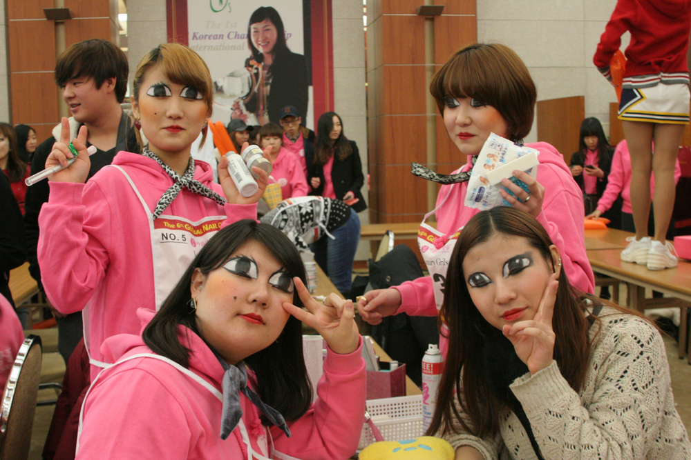 <p>One trio of students and their hand model from The Beautiful People Beauty School livened up the Team Relay competition with anime eyes.</p>