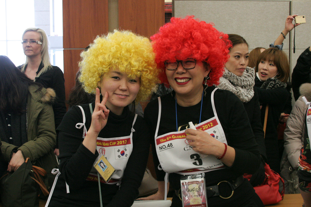 <p>Choi Kyung Hee (right) cheered on her students at the&nbsp;Choi Kyung Hee Nail Academy.</p>