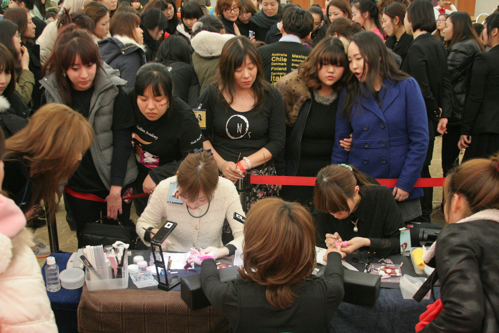 <p>Tomomi Sukigara and Tomoko Suzuki created French Sculpture nails in the Top Artist competition and placed second and third, respectively.</p>