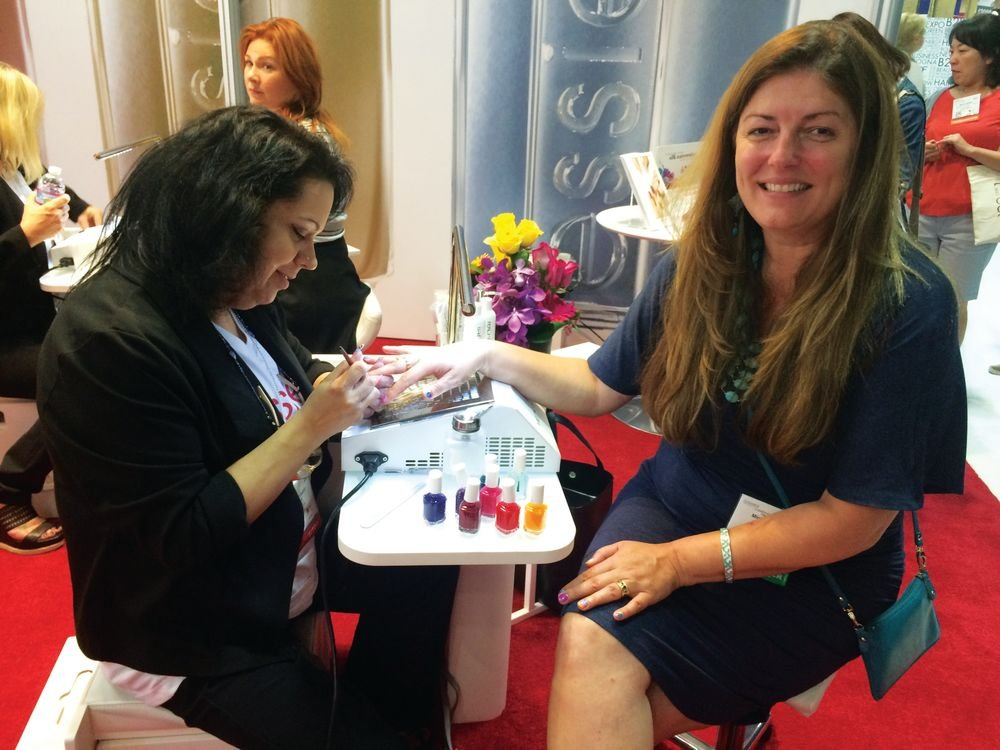 <p>NAILS' Michelle Mullen enjoys an Essie watercolor manicure from Kelcey Haque.</p>