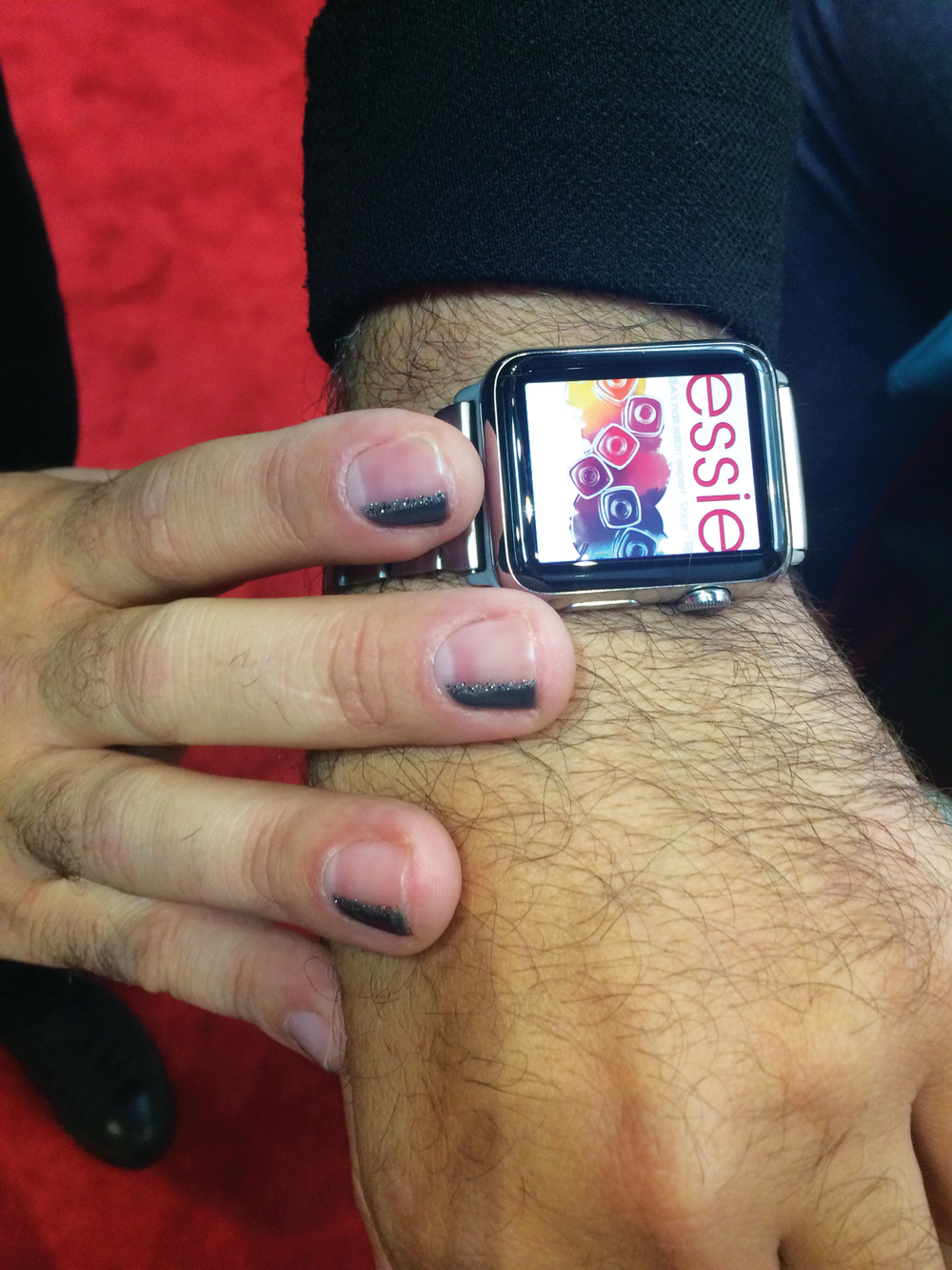 <p>Gino Trunzo's Essie manicure goes perfectly with his Apple Watch display.</p>