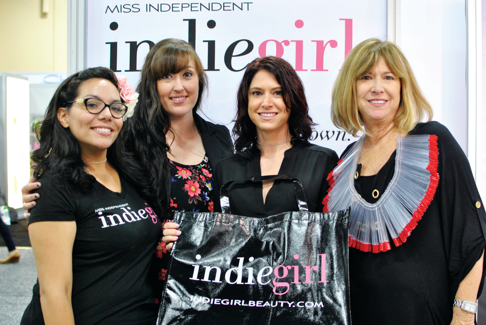 <p>IndieGirl's Heather Flores, Christina Flint, Natalie De Witte, and Rhonda Tooker show off their nail tip necklace made of over 250 tips, all painted with less than a single bottle of IndieGirl gel-polish.</p>