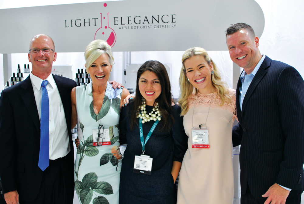 <p>Light Elegance's Jim McConnell, Lezlie McConnell, Lexy McLellan, and Joseph McLellan talked about the company's new Lexy Line with NAILS' Beth Livesay (center).</p>