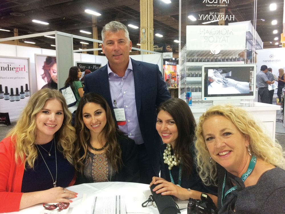 <p>Morgan Taylor's Taylor Daniel and Morgan Haile took a break from discussing their Urban Cowgirl collection to pose with Danny Haile, NAILS' Beth Livesay and Erika Kotite.</p>