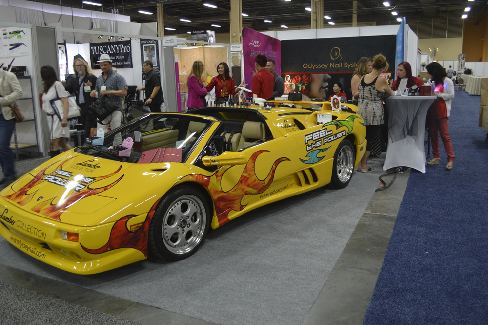 <p>A bright yellow Lamborghini at the Odyssey Nail booth stopped traffic and focused attention on its MetalGel and Hydro Gel collections.</p>
