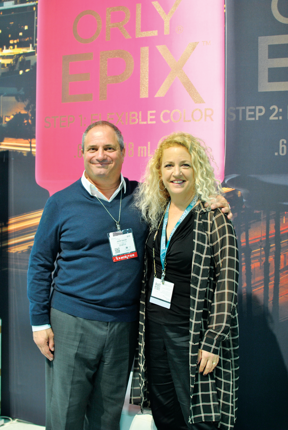 <p>Orly&rsquo;s John Galea and Erika Kotite are dwarfed by the company&rsquo;s Epix backdrop. The company is celebrating its 40th year with some great new products and events.</p>