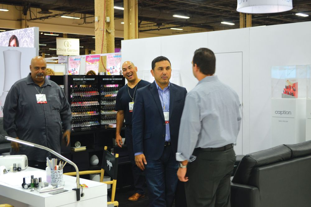 <p>Young Nails&rsquo; Greg Salo is never still at Cosmoprof &mdash; or anywhere else for that matter. He mugs for the camera while brother Habib chats with a distributor.</p>