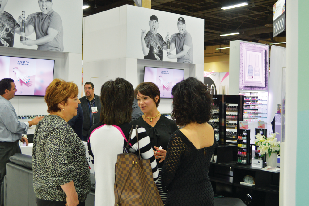<p>Young Nails&rsquo; VP of sales Felicia Jayes is surrounded by buyers and distributors wanting to know what&rsquo;s new with the company&rsquo;s Caption line.</p>