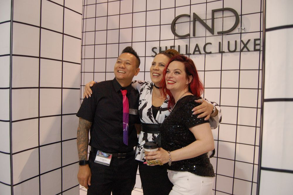 <p>Tan Nguyen, Tracey Lee, and Valerie Ducharme at the CND booth.</p>