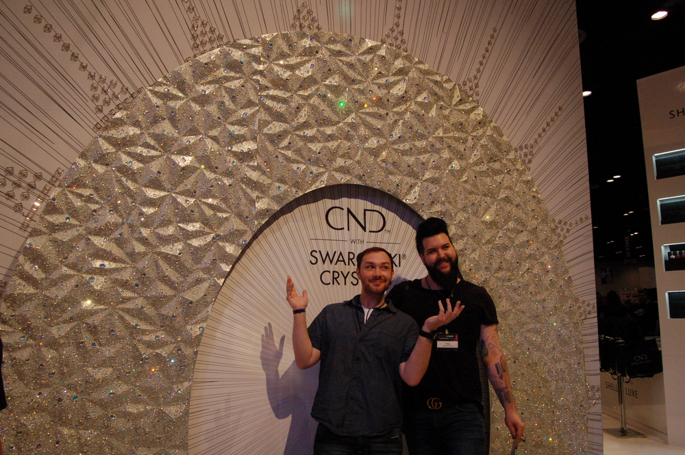 <p>Braden Jahr and Nellie Neal at the CND booth.</p>