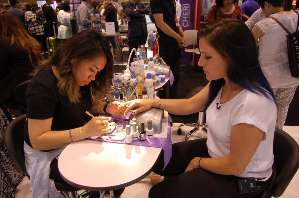 <p>Suni Nguyen does nails for Cheryl Feinberg of LeChat.</p>