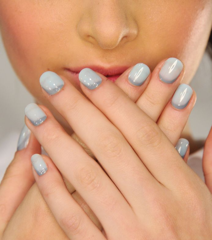 <p>A custom blended pale aquamarine composed of Morgan Taylor in Varsity Jacket Blues and Make It Last clear top coat was applied as the base and was topped with a cuticle-hugging, asymmetrical swoosh in Morgan Taylor Who-Dini.&nbsp;Photo courtesy of Morgan Taylor.&nbsp;</p>