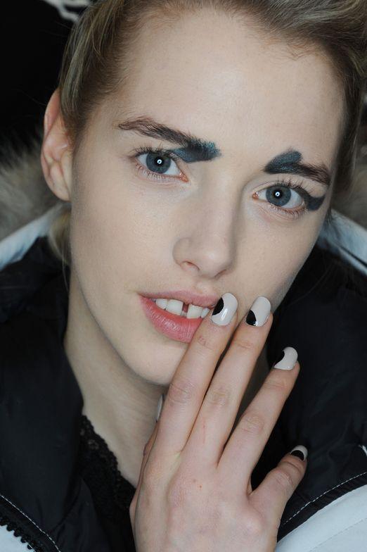 <p>Gina Edwards for Morgan Taylor created large black dots on nails at Zero + Maria Cornejo.</p>