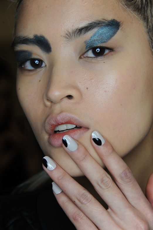<p>Asymetric dots appeared to be sliding off nails (inspired by Dali) at Zero + Maria Cornejo.</p>