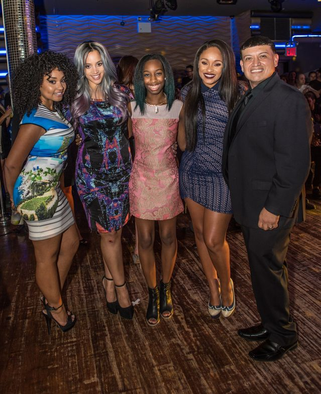 <p>Orange is the New Black star Dascha Polanco, reality star Tahiry Jose, and Valerie Lora posed with Wall and Mr. Luis then stayed to see the Fashion Show.Photo courtesy of Samantha Morales Photography.&nbsp;</p>