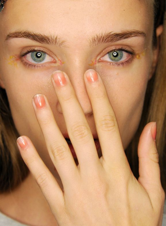 <p>A custom mix of&nbsp;Morgan Taylor's&nbsp;coral&nbsp;creme&nbsp;Color Me Bold&nbsp;and light mauve cream&nbsp;Coming up Roses&nbsp;was applied at the very base of the nail at the Monique Lhuillier show. Photo courtesy of Morgan Taylor.&nbsp;&nbsp;&nbsp;</p>