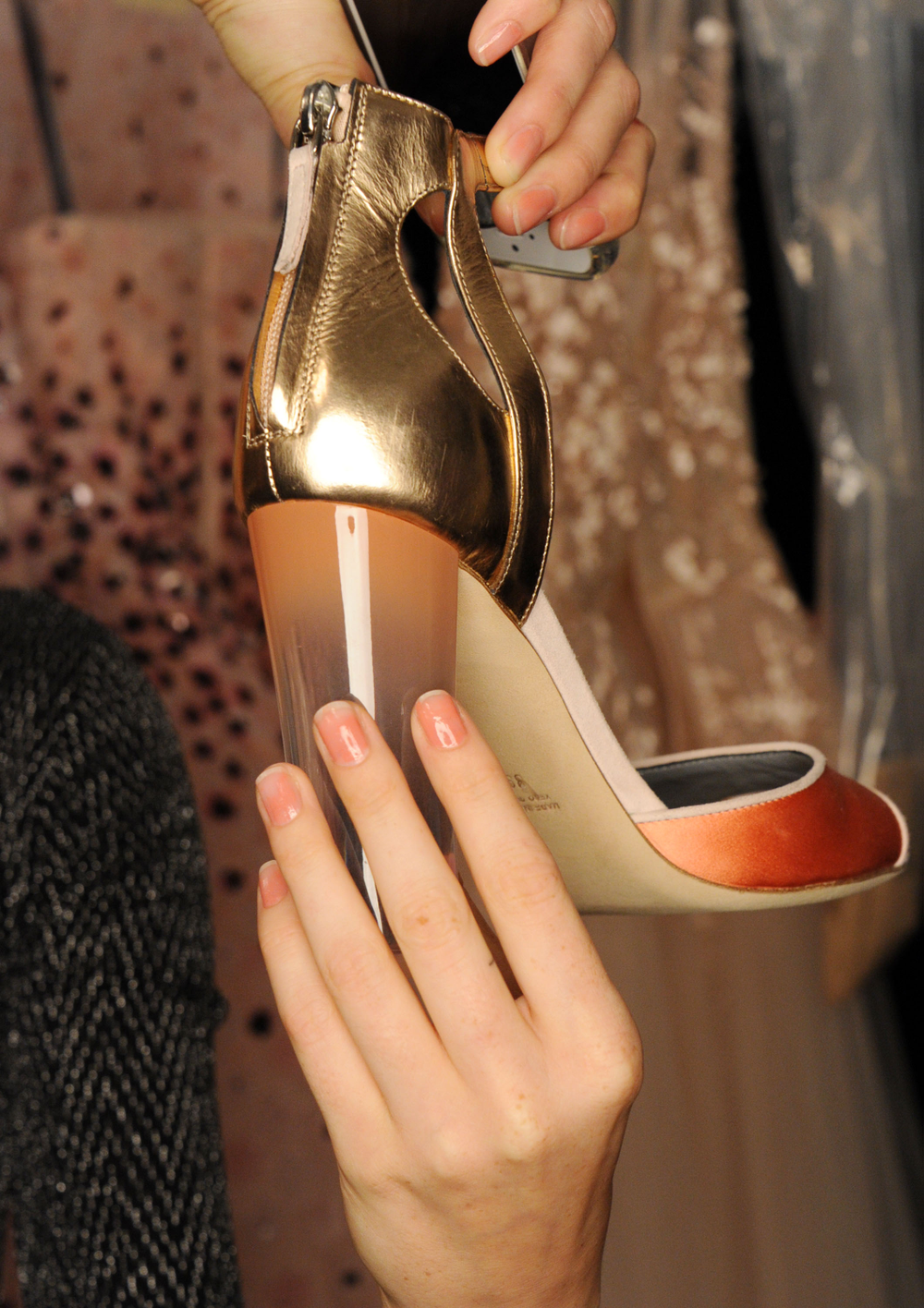 <p>Gina Edwards was inspired by the gorgeous thick, clear Lucite heels featured in the show and Lhuillier's own inspiration of the pastels illuminating the sky just before sunrise. Photo courtesy of Morgan Taylor. &nbsp;</p>