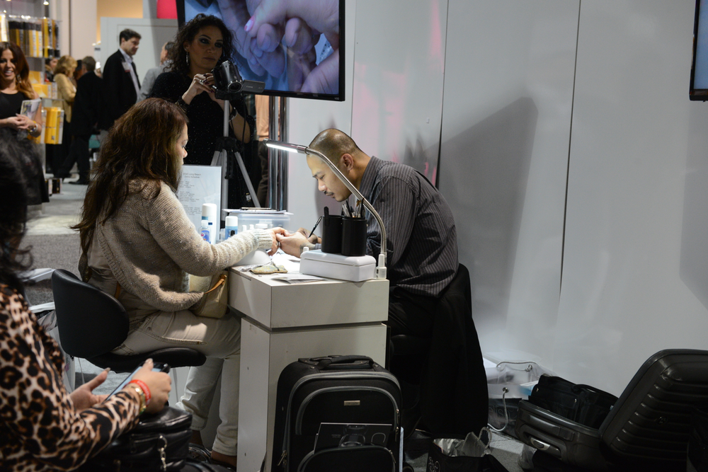 <p>Vu Ong demoing at the Gelish booth</p>