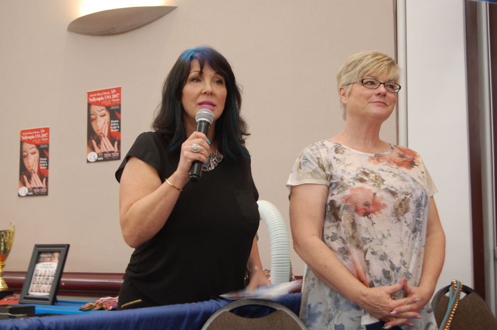 <p>Athena Elliott and Donna Schur welcoming the crowd to the Meet &amp; Mingle event, which took place the night before the show floor opened</p>