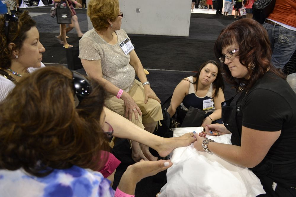 <p>Breeanne Christiansen of Young Nails gives glitter pedicures that girls went crazy over.</p>