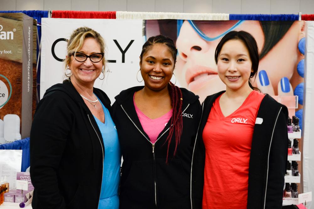 <p>Shari Dust, Kanisha Muslar, and Shiori Durham at the Orly booth</p>