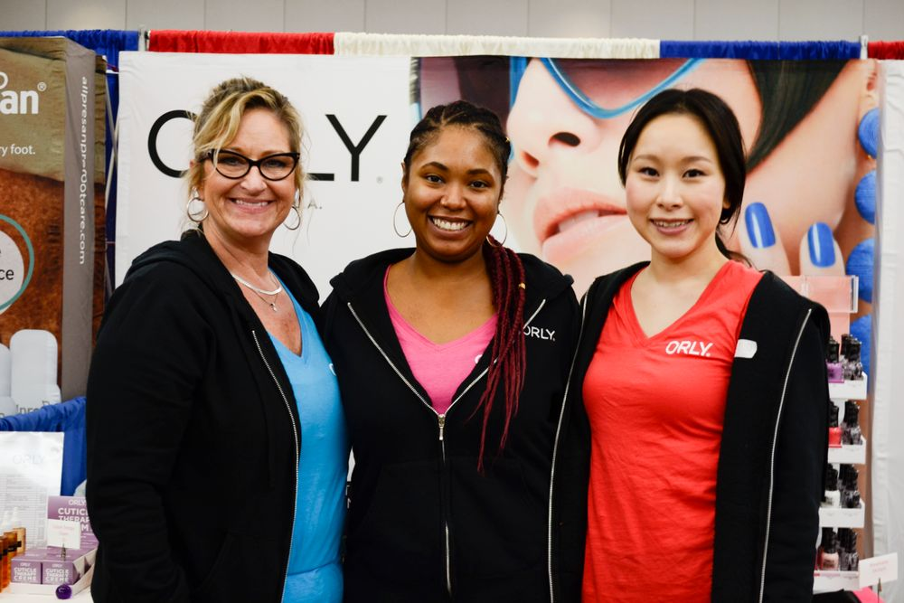<p>Shari Dust, Kanisha Muslar, and Shiori Durham at the Orly booth</p>