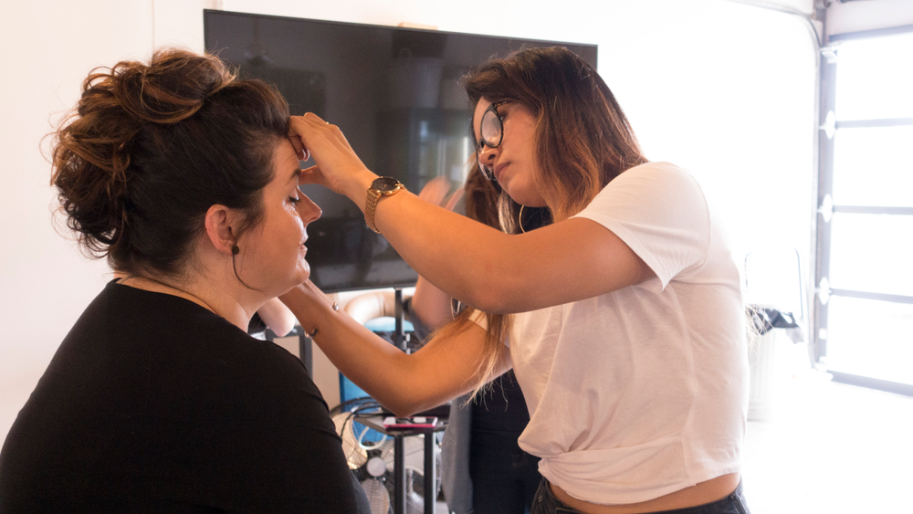 <p>Heather getting makeup done by Stephanie Navarro </p>
