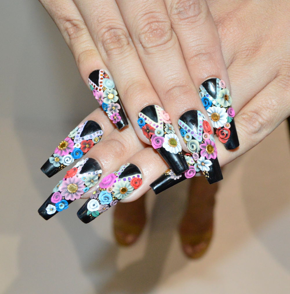 <p>Israelle Wireman models a flower nail design for Wildflowers Nails. </p>