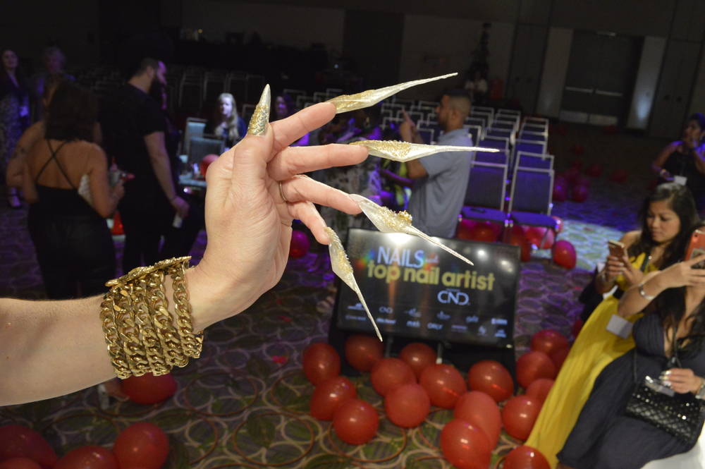 <p>Top 11 contestant Melissa Salazar brought her nail game to the event. </p>