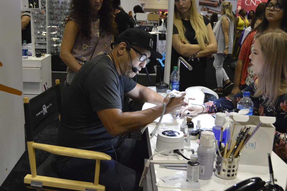 <p>Greg Salo of Young Nails demos on the show floor. </p>