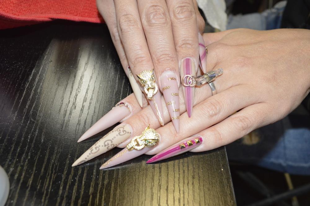 <p>Deanna Stelmaschuk shows off her nails.</p>