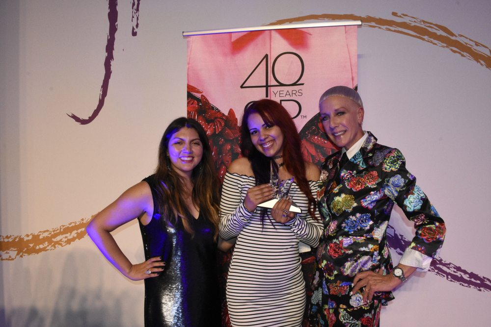 <p>Winner Ashton Harlan with NAILS' Beth Livesay and CND's Jan Arnold. </p>