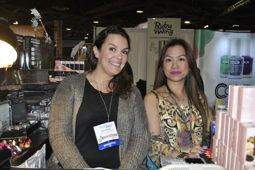 <p>Nail tech Erin Hoover did many a demo at Color Club's booth. Here she is with Cathy Cheong.</p>