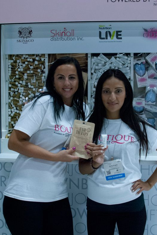 <p>Sandy Aragon and Aurora Pantilie helped guests pick out samples at Boutique by Glossybox, where donations went to charity.</p>