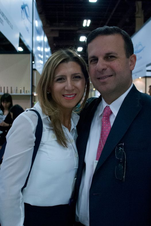 <p>Dermelect founder Amos Lavian and his wife walk the show floor.</p>