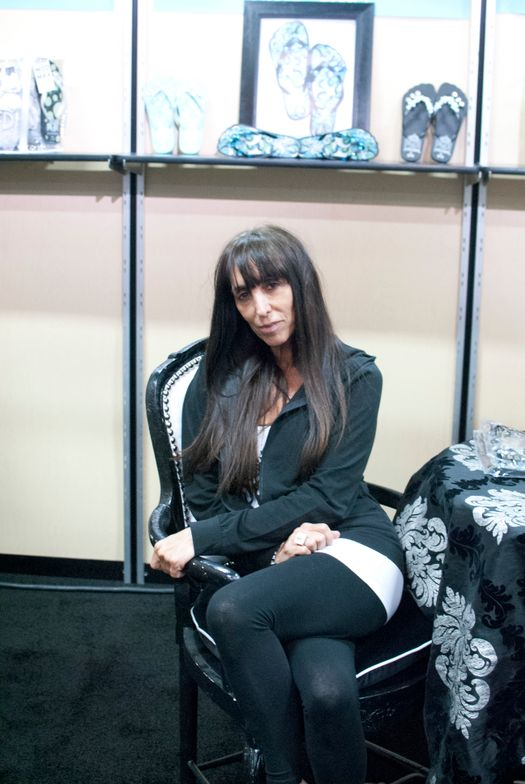 <p>Pedi Princess founder Laura Slipak lounges in her custom designed booth.</p>