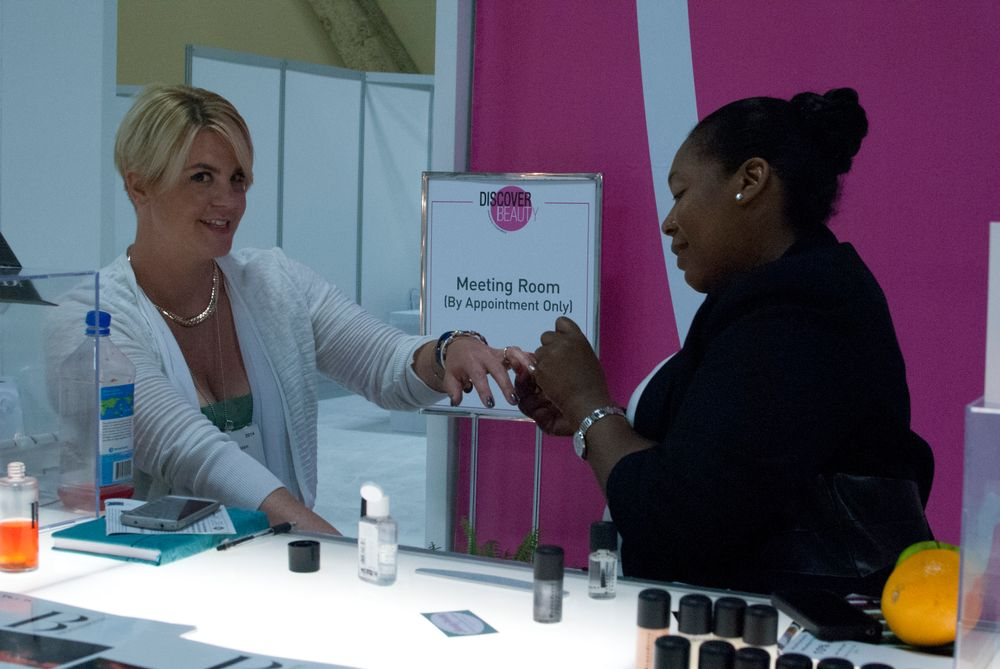 <p>Celebrity nail tech Bernadette Thompson polishes nails at her booth.</p>