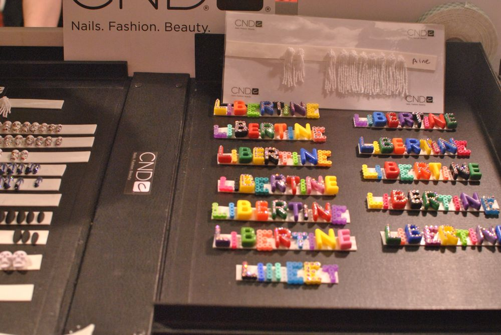 <p>Nails at Libertine were a matte white, topped with letters that spelled out the design house name.&nbsp;</p>