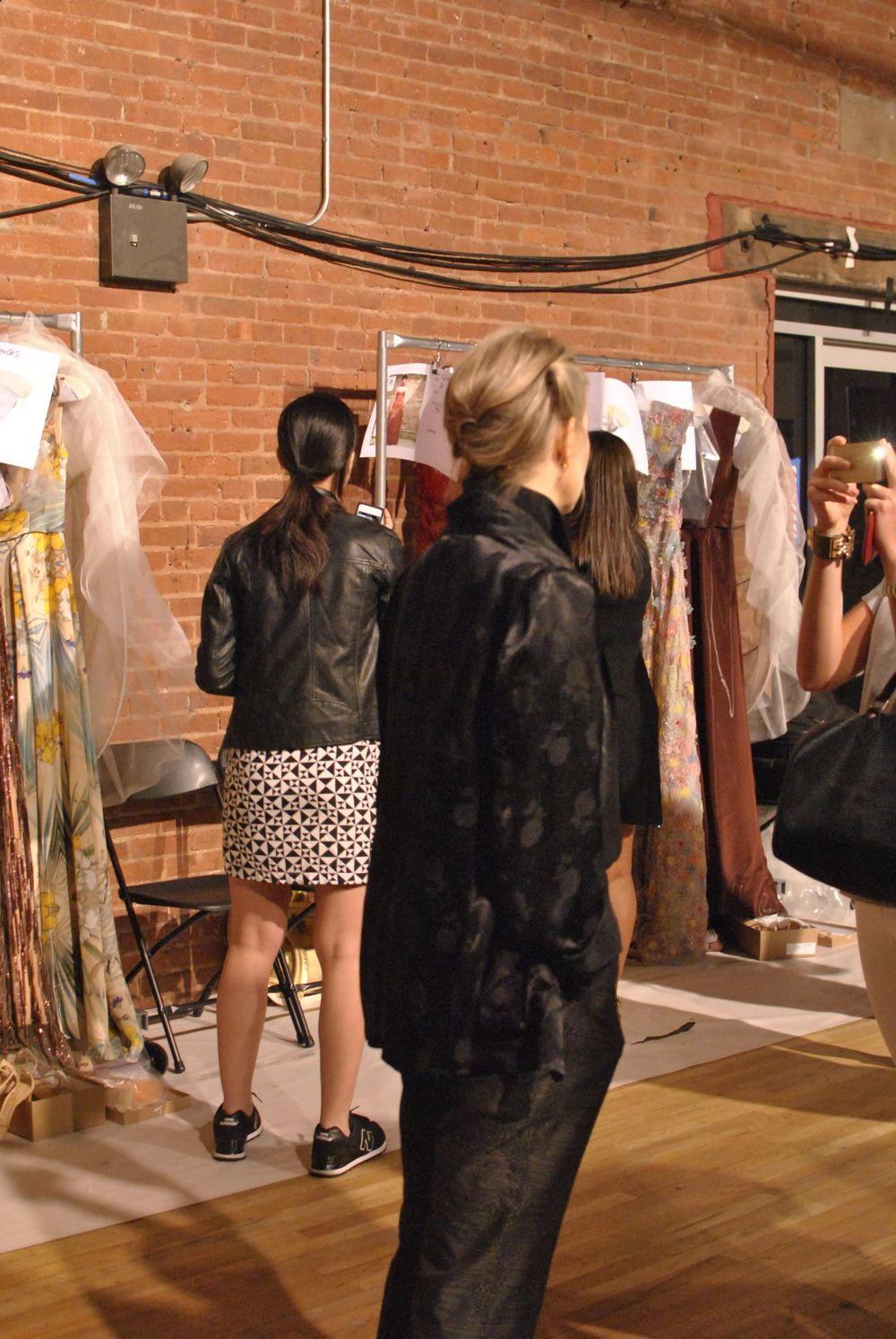 <p>Designer Jenny Packham was backstage talking to cameras constantly.&nbsp;</p>