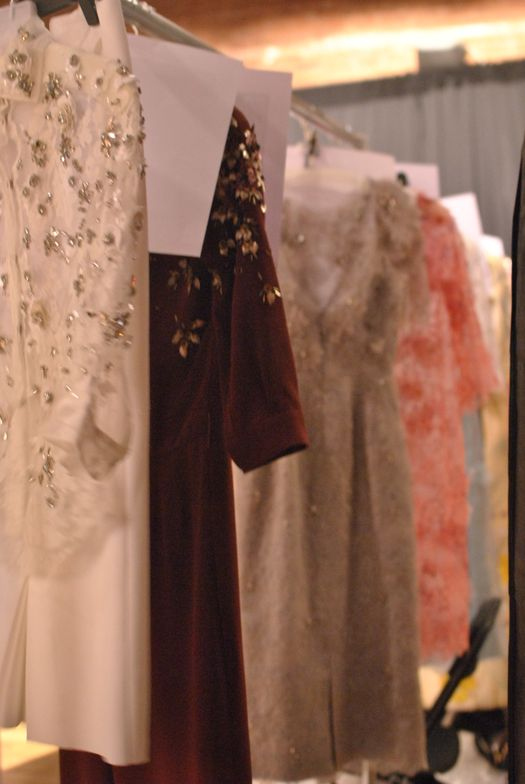 <p>Glittering garments hung all over the backstage area at Jenny Packham.&nbsp;</p>